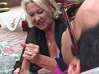 Blonde granny jerking off a huge cock before being fucked hard