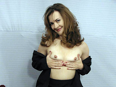 Slutty mature with small tits stripping seductively